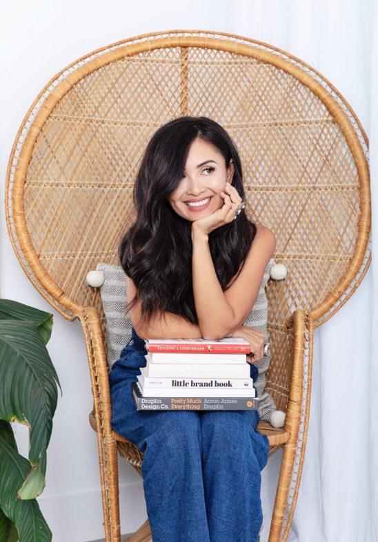 Kalika Yap with a set of books while sitting for kalika.com headshots