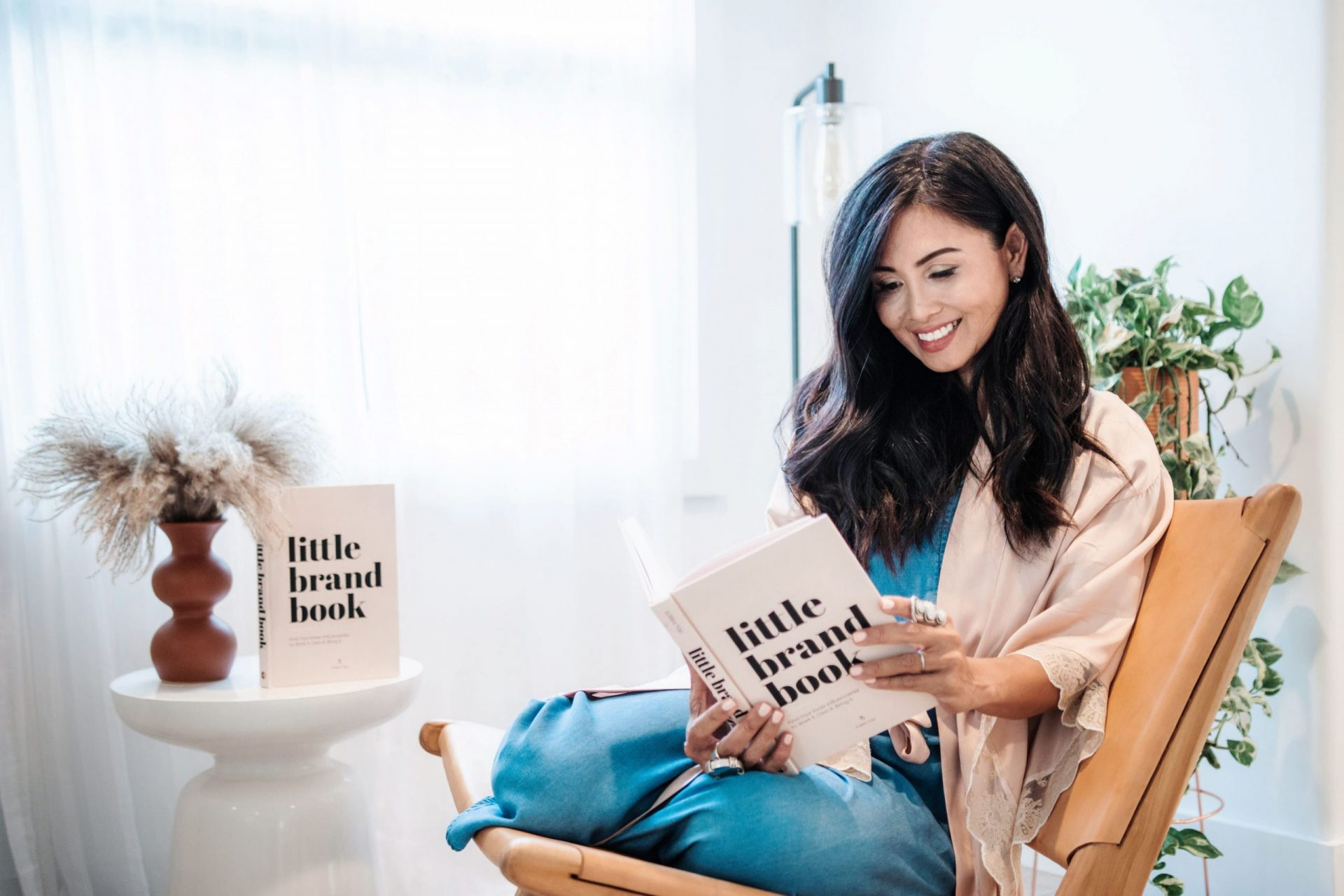 Kalika Yap reading little brand book for kalika.com headshot photoshoot